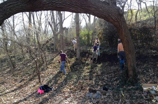 The trailbuilders at work on Roanoke Park's newest amenity. Thanks to BikeWalkKC.org for the picture. (See Information > Photo Galleries > Event Photos, for more pics.)